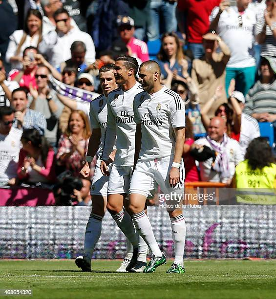 Gareth Bale Cristiano Ronaldo and Karim Benzema of Real Madrid celebrate after scoring during the La Liga match between Real Madrid CF and Granda CF...