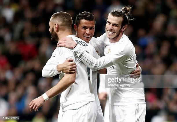Gareth Bale Cristiano Ronaldo and Karim Benzema of Real Madrid celebrate after scoring a goal during the La Liga football match between Real Madrid...