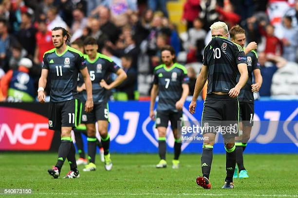 Gareth Bale James Chester Joe Allen Aaron Ramsey and David Edwards of Wales show their dejection after the UEFA EURO 2016 Group B match between...