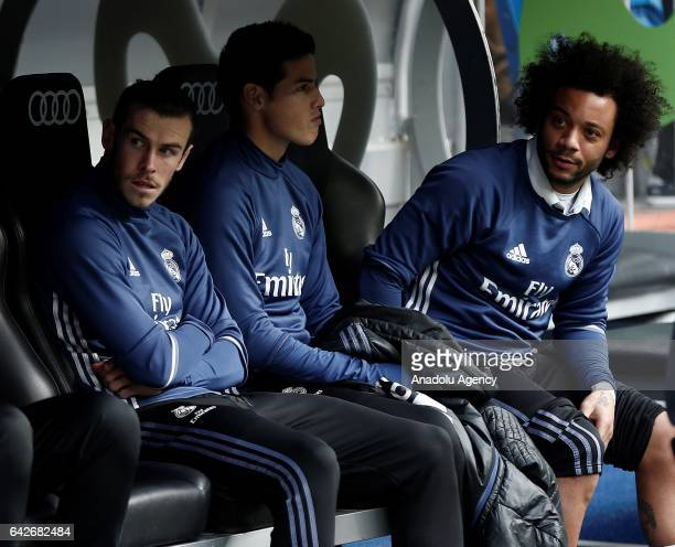 Gareth Bale James Rodriguez and Marcelo Vieira of Real Madrid watch the match from substitute bench during the first half of La Liga football match...