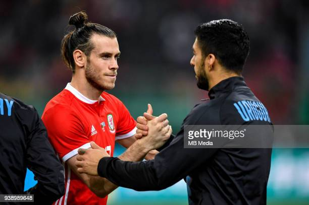 Gareth Bale left of Wales national football team shakes hands with Luis Suarez of Uruguay national football team in their final match during the 2018...