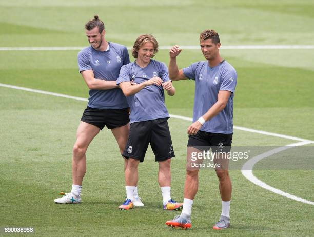 Gareth Bale Luka Modric and Cristiano Ronaldo share a light moment during training at the Real Madrid UEFA Open Media Day at Valdebebas training...