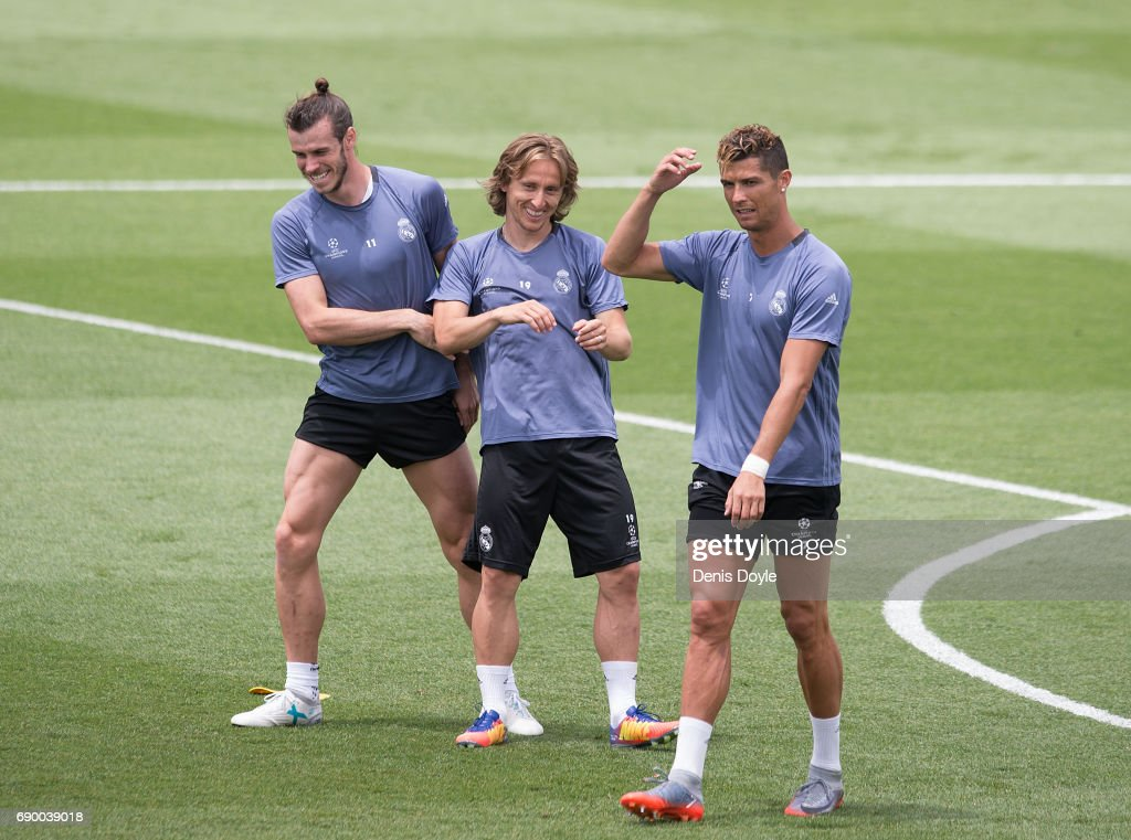 Gareth Bale, Luka Modric and Cristiano Ronaldo share a light moment during training at the Real Madrid UEFA Open Media Day at Valdebebas training ground on May 30, 2017 in Madrid, Spain.