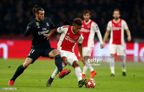 Gareth Bale of Madrid challenges David Neres of Amsterdam during the UEFA Champions League Round of 16 First Leg match between Ajax and Real Madrid...