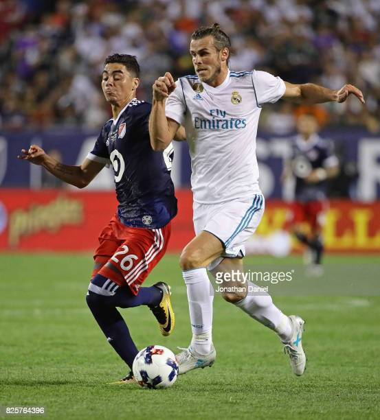 Gareth Bale of Real Madrid advances the ball under pressure from Miguel Almiron of the MLS AllStars during the 2017 MLS All Star Game at Soldier...