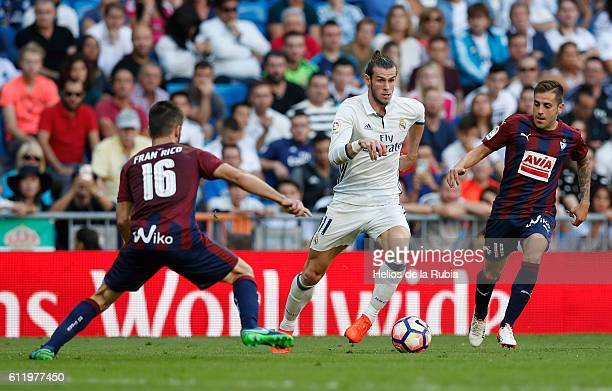 Gareth Bale of Real Madrid against Ruben Pena and Fran Rico of Eibar FC compete for the ball during the La Liga match between Real Madrid CF and SD...