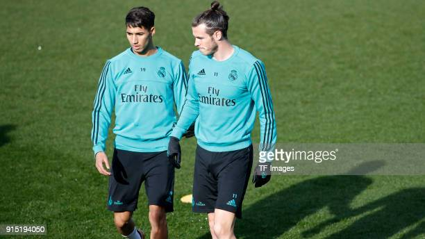 Gareth Bale of Real Madrid and Achraf Hakimi of Real Madrid look on during a training session at Valdebebas training ground on January 23 2018 in...