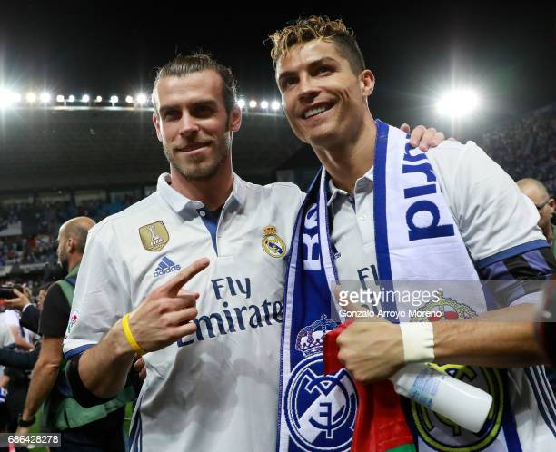 Gareth Bale of Real Madrid and Cristiano Ronaldo of Real Madrid celebrate being crowned champions following the La Liga match between Malaga and Real...