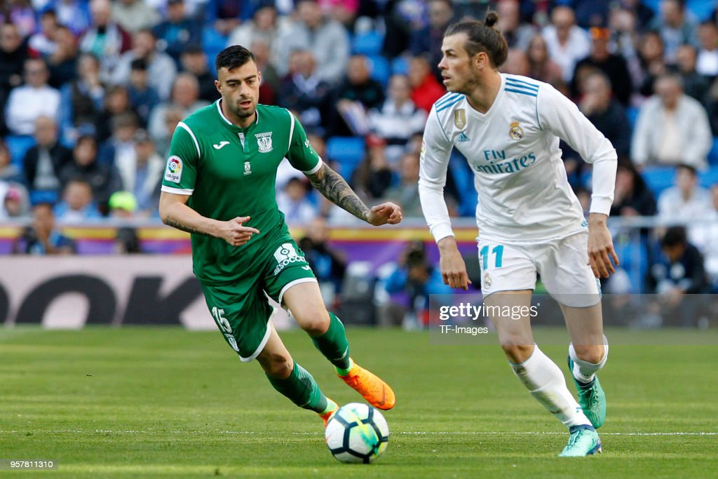Gareth Bale of Real Madrid and Diego Rico of Leganes battle for the ball during the La Liga match between Real Madrid and Leganes at Estadio Santiago Bernabeu on April 28, 2018 in Madrid, Spain.