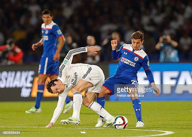 Gareth Bale of Real Madrid and Hernan Bernardello of Cruz Azul compete for the ball during the FIFA Club World Cup Semi Final match between Cruz Azul...
