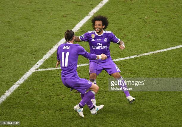 Gareth Bale of Real Madrid and Marcelo of Real Madrid celebrate during the UEFA Champions League Final between Juventus and Real Madrid at National...