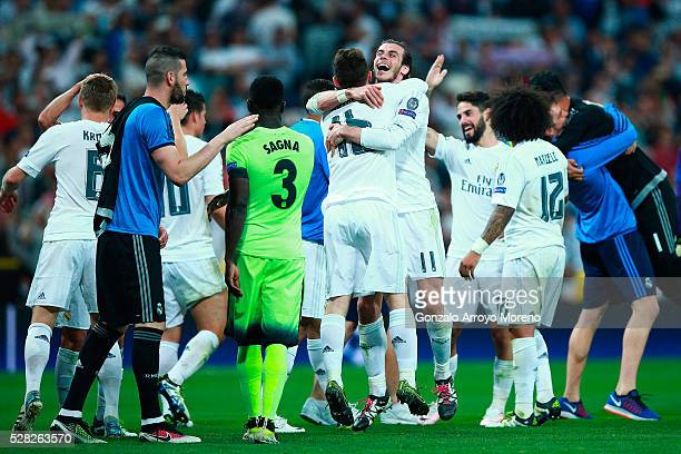 Gareth Bale of Real Madrid and Mateo Kovacic of Real Madrid celebrate victory during the UEFA Champions League semi final, second leg match between...