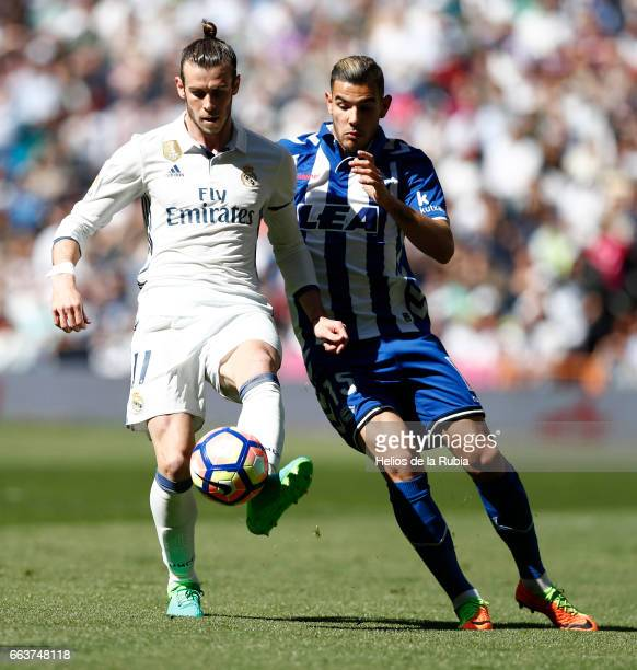 Gareth Bale of Real Madrid and Theo Hernandez of Deportivio Alaves compete fir the ball during the La Liga match between Real Madrid and Real Betis...
