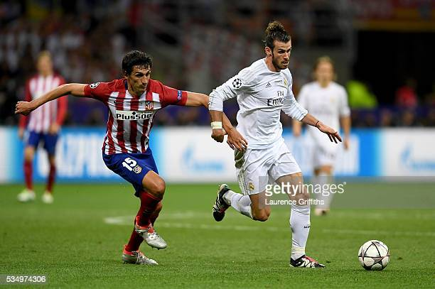 Gareth Bale of Real Madrid battles for the ball with Stefan Savic of Atletico Madrid during the UEFA Champions League Final match between Real Madrid...