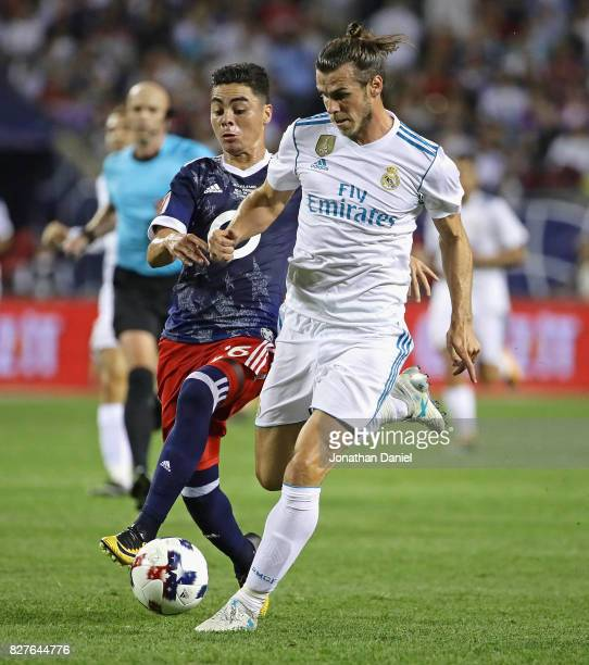 Gareth Bale of Real Madrid battles with Miguel Almiron of the MLS AllStars during the 2017 MLS All Star Game at Soldier Field on August 2 2017 in...