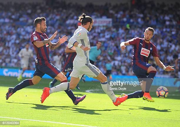 Gareth Bale of Real Madrid beats Antonio Luna of SD Eibar in action during the La Liga Match between Real Madrid CF and SD Eibar at estadio Santiago...