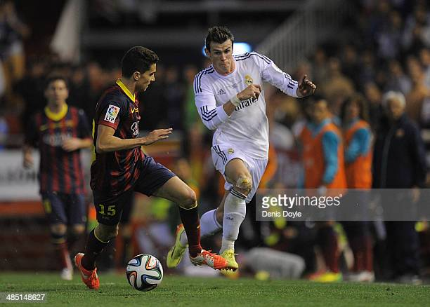 Gareth Bale of Real Madrid beats Marc Bartra of Barcelona during the Copa del Rey Final between Real Madrid and Barcelona at Estadio Mestalla on...