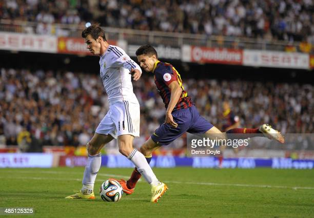 Gareth Bale of Real Madrid beats Marc Bartra of Barcelona to score Real's 2nd goal during the Copa del Rey Final between Real Madrid and Barcelona at...