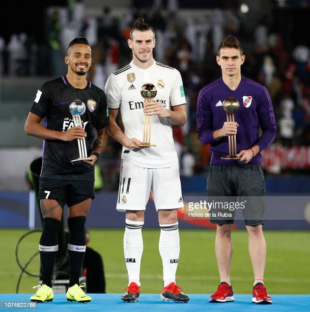 Gareth Bale of Real Madrid Caio of Al Ain and Rafael Santos Borre of River Plate hold their Adidas golden ball trophies during the medal ceremony...