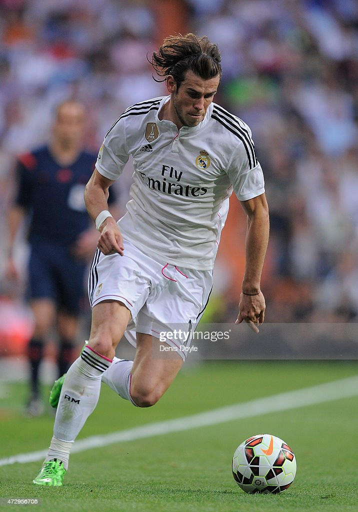 Gareth Bale of Real Madrid carries the ball forward during the La Liga match between Real Madrid CF and Valencia CF at Estadio Santiago Bernabeu on May 9, 2015 in Madrid, Spain.