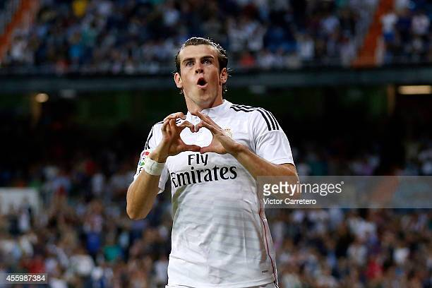 Gareth Bale of Real Madrid celebrates after scoring during the La Liga match between Real Madrid CF and Elche FC at Estadio Santiago Bernabeu on...