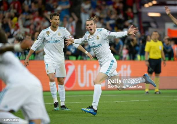 Gareth Bale of Real Madrid celebrates after scoring his first goal during the UEFA Champions League Final between Real Madrid and Liverpool at NSC...