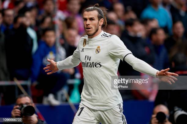 Gareth Bale of Real Madrid celebrates after scoring his sides first goal during the week 23 of La Liga match between Atletico Madrid and Real Madrid...