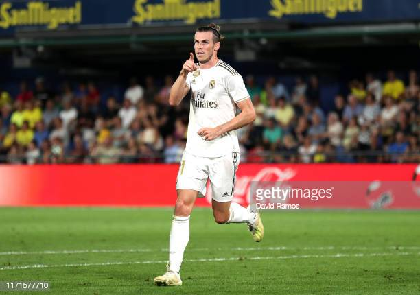 Gareth Bale of Real Madrid celebrates after scoring his sides first goal during the Liga match between Villarreal CF and Real Madrid CF at Estadio de...
