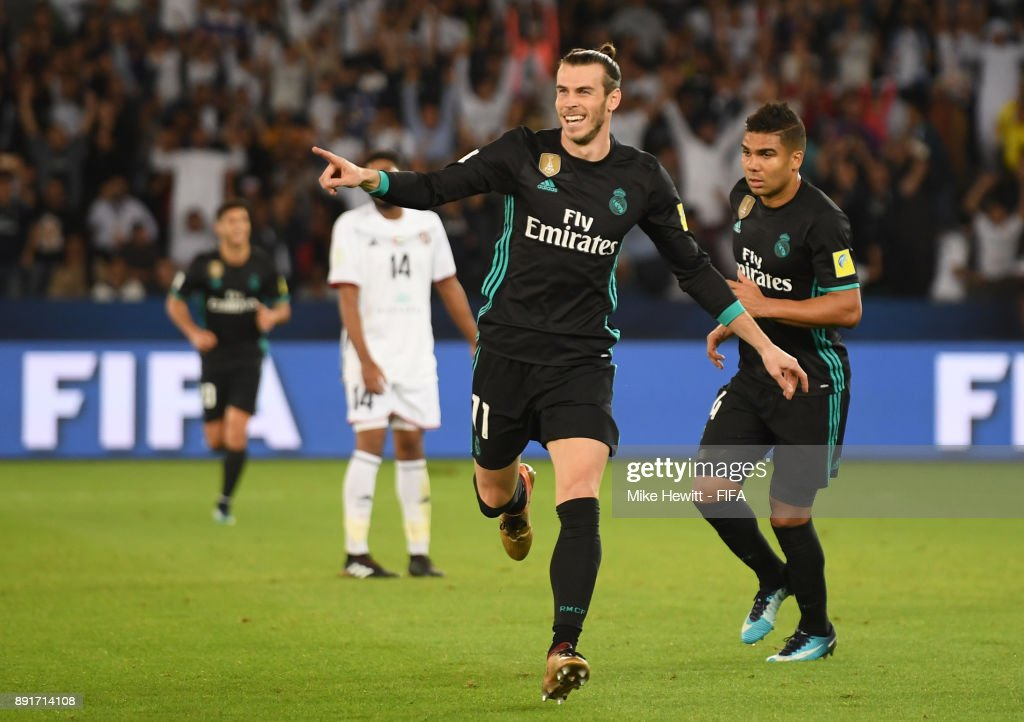Gareth Bale of Real Madrid celebrates after scoring his sides second goal during the FIFA Club World Cup UAE 2017 semi-final match between Al Jazira and Real Madrid on December 13, 2017 at the Zayed Sports City Stadium in Abu Dhabi, United Arab Emirates.