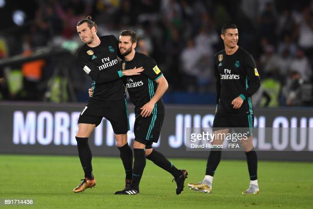Gareth Bale of Real Madrid celebrates after scoring his sides second goal with Nacho of Real Madrid during the FIFA Club World Cup UAE 2017 semifinal...