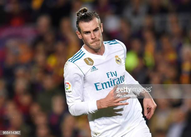 Gareth Bale of Real Madrid celebrates after scoring his sides second goal during the La Liga match between Barcelona and Real Madrid at Camp Nou on...