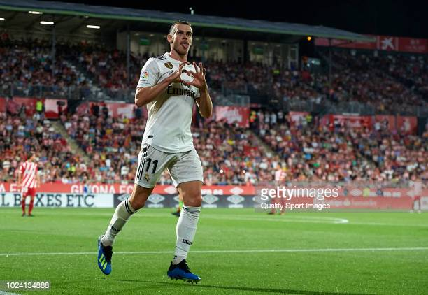 Gareth Bale of Real Madrid celebrates after scoring his sides third goal during the La Liga match between Girona FC and Real Madrid CF at Montilivi...