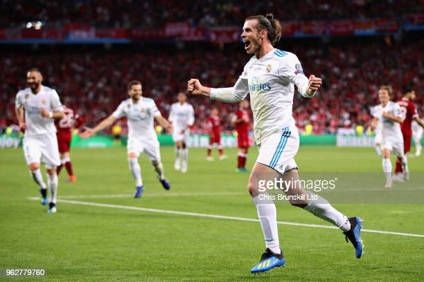 Gareth Bale of Real Madrid celebrates after scoring his sides third goal during the UEFA Champions League final between Real Madrid and Liverpool at...