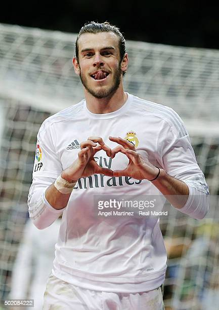 Gareth Bale of Real Madrid celebrates after scoring his team's eighth goal during the La Liga match between Real Madrid CF and Rayo Vallecano at...