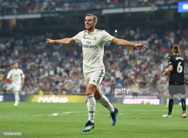 Gareth Bale of Real Madrid celebrates after scoring his teams opening goal during the La Liga match between Real Madrid CF and CD Leganes at Estadio...