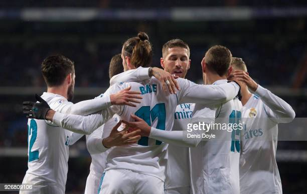 Gareth Bale of Real Madrid celebrates after scoring his team's opening goal during the La Liga match between Real Madrid and Getafe at Estadio...