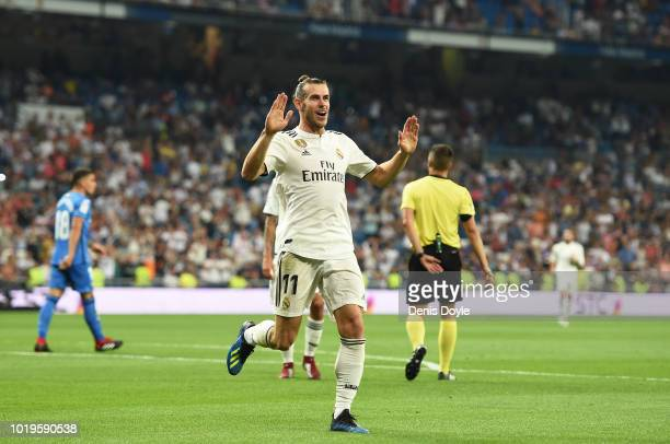 Gareth Bale of Real Madrid celebrates after scoring his teams second goal during the La Liga match between Real Madrid CF and Getafe CF at Estadio...