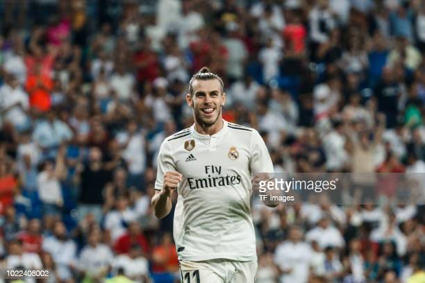 Gareth Bale of Real Madrid celebrates after scoring his team`s second goal during the La Liga match between Real Madrid CF and Getafe CF at Estadio...