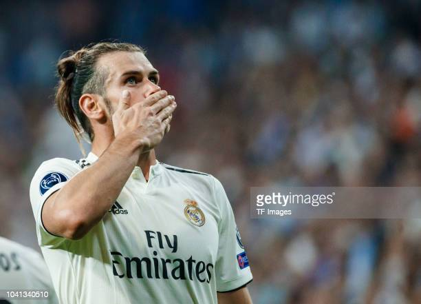 Gareth Bale of Real Madrid celebrates after scoring his team`s second goal during the UEFA Champions League Group G match between Real Madrid and AS...