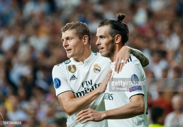 Gareth Bale of Real Madrid celebrates after scoring his team`s second goal with Toni Kroos of Real Madrid during the UEFA Champions League Group G...
