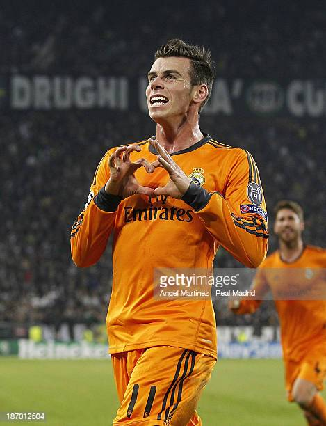 Gareth Bale of Real Madrid celebrates after scoring his team's second goal during the UEFA Champions League Group B match between Juventus and Real...