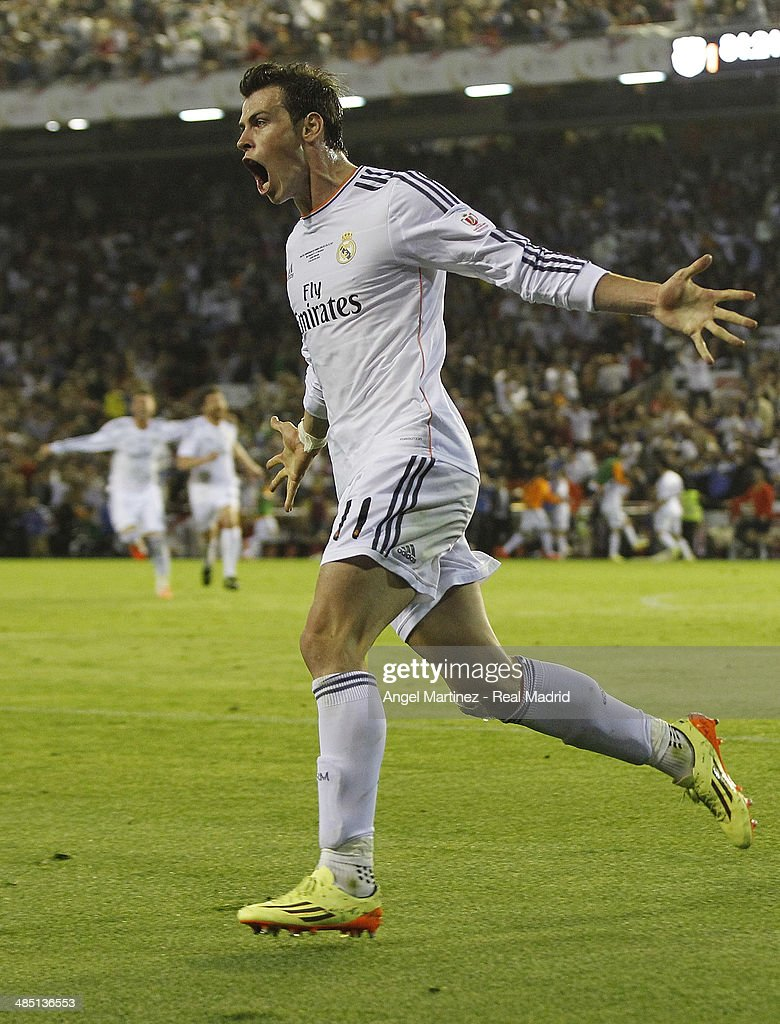 Gareth Bale of Real Madrid celebrates after scoring his team's second goal during the Copa del Rey Final between Real Madrid and Barcelona at Estadio Mestalla on April 16, 2014 in Valencia, Spain.