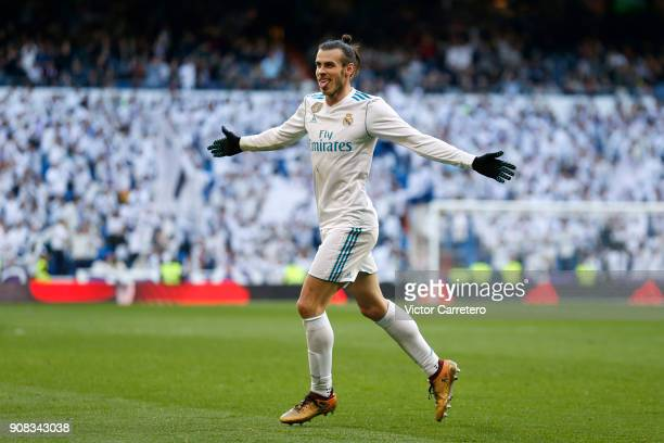 Gareth Bale of Real Madrid celebrates after scoring his team's second goal during the La Liga match between Real Madrid and Deportivo La Coruna at...