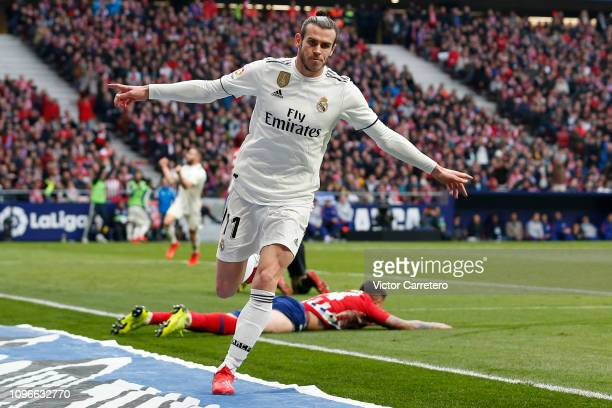 Gareth Bale of Real Madrid celebrates after scoring his team's third goal during the La Liga match between Club Atletico de Madrid and Real Madrid CF...