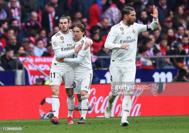 Gareth Bale of Real Madrid celebrates after scoring his team's third goal with Luka Modric during the La Liga match between Club Atletico de Madrid...