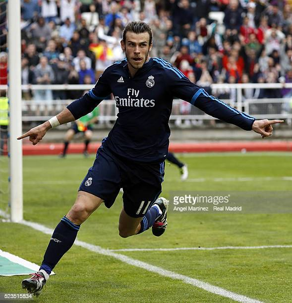 Gareth Bale of Real Madrid celebrates after scoring his team's third goal during the La Liga match between Rayo Vallecano and Real Madrid CF at...