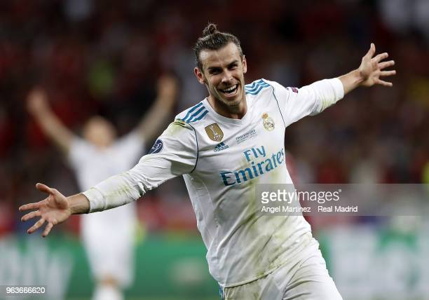 Gareth Bale of Real Madrid celebrates after scoring his team's third goal during the UEFA Champions League Final between Real Madrid and Liverpool at...