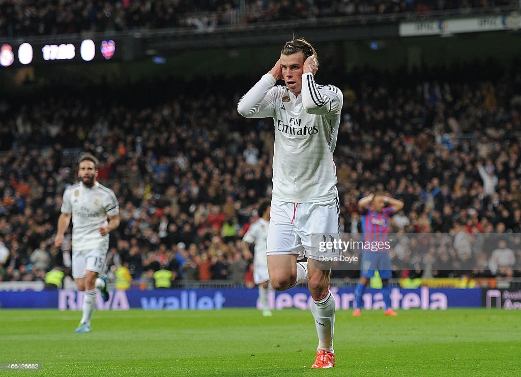 Gareth Bale of Real Madrid celebrates after scoring Real's opening goal during the La Liga match between Real Madrid CF and Levante UD at Estadio Santiago Bernabeu on March 15, 2015 in Madrid, Spain.