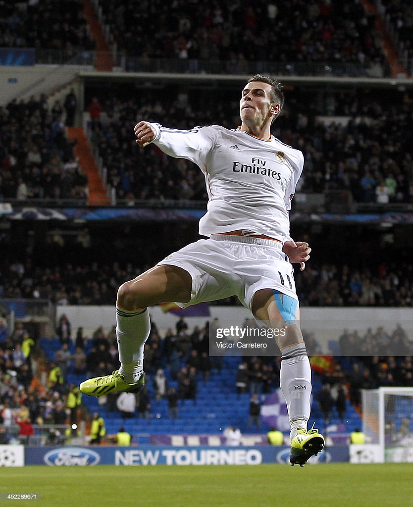 Gareth Bale of Real Madrid celebrates after scoring the opening goal during the UEFA Champions League Group B match between Real Madrid and Galatasaray AS at Estadio Santiago Bernabeu on November 27, 2013 in Madrid, Spain.