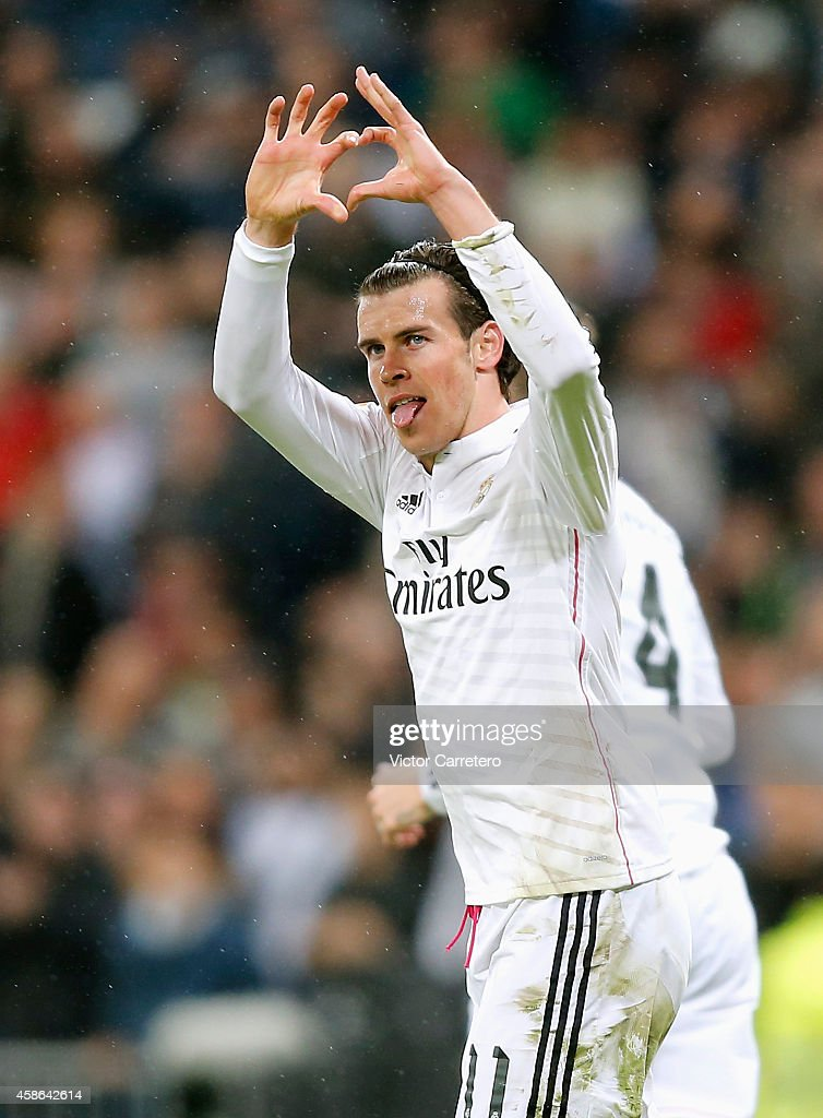 Gareth Bale of Real Madrid celebrates after scoring the opening goal during the La Liga match between Real Madrid and Rayo Vallecano at Estadio Santiago Bernabeu on November 8, 2014 in Madrid, Spain.
